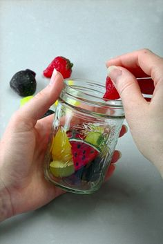 To make a gel candle, add your embedments first, using glue if necessary, and then pour your wax.