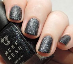 Black Star Sapphire is a black textured holo micro glitter polish by Mckfresh Nail Attire, shown here without top coat swatched by @procrastinatingpolishr.