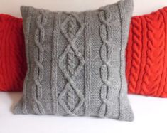 This is a listing for a custom hand knit pillow cover in red color with an intricate cable stitch design on front and back as well. The pillow cover closes with an envelope style and my signature crochet buttons. The pillow could be closed with wooden buttons. Just specify in Note to seller.  This pillow case would be a cheerful addition to any room and a perfect gift to yourself or to a loved one ! Yarn :acrylic Hand wash cold.Lay flat dry.  This pillow cover is available to fit the…