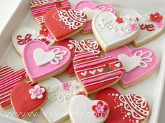 Pretty hearts.  Look like fondant with royal icing combo.