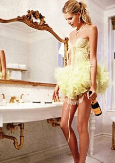 There are not a lot of occasions in my life that require wandering into gilded restrooms in a corset and tutu while carrying champagne.