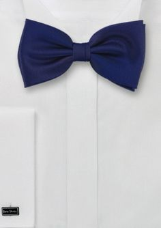Dark blue bow tie  Sapphire blue bow-tie    Elegant bow tie in dark blue with brilliant sapphire-blue shine. This bow tie is a perfect alternative to the solid black bow tie. It matches well with dark gray, black or midnight blue tuxedo or classic 2-piece suit. Made from care-free microfiber fabric.