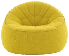 Ottoman Armchair sold by Ligne Roset. Inspired by a traditional Moroccan footstool, this brilliant yellow armchair is sure to brighten the room.