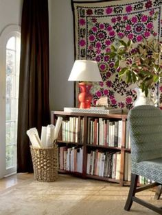 wall textile.  bookcase.