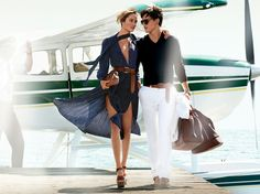 Michael Kors Spring / Summer 2014  Models: Karmen Pedaru and Simon Nessman  Photographer: Mario Testino  Impact: Showcasing the brand's Spring / Summer 2014 natural leather accessories and the collection's white pants and light and airy dress, Michael Kors 'latest campaign Sees icts models perfectly dressed for a romantic escape.