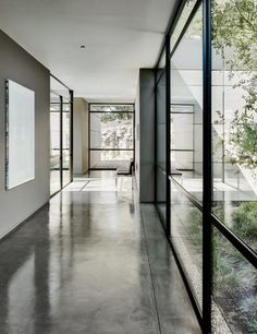 Connection to environment, raw concrete floor sacked to simulate leather and black steel, full-height windows  Carmel Residence | Jim Jennings Architecture