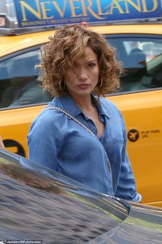 Hair raising:No doubt helping her to stay cool, the star is currently rocking short hair which she wore in messy curls