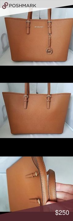 """🌹Michael Kors Jet Set Travel Medium Tote Saffiano LIKE NEW!  Used twice - Dust Bag Included No tags - small minor flaws -See Last Picture for the three flaws- COLOR: Luggage  ·Saffiano Leather  ·   Exterior features Gold-tone hardware, signature logo metal medallion  ·   Top Zip Closure  ·    Interior features large middle zip compartment, zip pocket and 1 slip pocket and one side zip pocket  ·    Double top handles with 8-1/2"""" drop   ·    Approximate measurement: 18"""" at top 15'' at bottom…"""