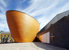 A Curved Wooden Chapel in a Northern Square - Architect Magazine