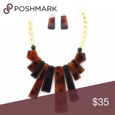 Celluloid Bib Statement Necklace Celluloid Bib Statement Necklace.  Size: 24 inch length and 2 inch extension Material: Plated metal , Genuine Stone, Acrylic Closure: Lobster clasp Jewelry Necklaces