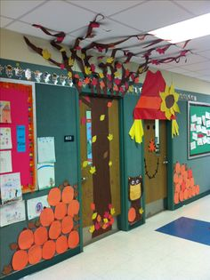 "I've ""Fall-en In Love"" with these 2 classroom doors that are side by side and decorated with autumn themes!"