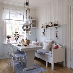 Lovely blue and white Swedish country dining space with an antique Swedish oil lamp
