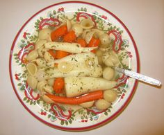 Chicken soup with carrots, parsnip, onion and shell pasta.