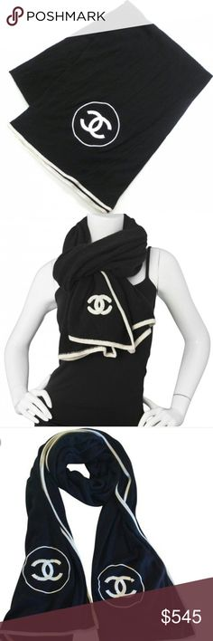 Chanel cashmere scarf This scarf provides a very elegant and classic look. It is a black square of cashmere with a white border that has a circle and Chanel CC logo in one corner stitched in white. The stitched logo is slightly raised and large for a dramatic effect.  look.Comes with Chanel boxing  Measurements: Length: 42 in Height: 74 in CHANEL Accessories Scarves & Wraps