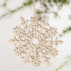 One of my favorite discoveries at WorldMarket.com: Laser Cut Wood Snowflake Ornaments Set of 4