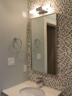 Stunning Tiled Wall For Vanity Area With Single Rounded Sink And Modern Frameless Mirror With Light Above
