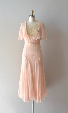 A romantic pale peach vintage dress. I love the stitching detail and snug fit over the hips and the flowing sheer skirt.