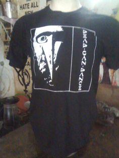 """Dead Can Dance R$ 35,00 + frete Todas as cores Personalizamos e estampamos a sua ideia: imagem, frase ou logo preferido. Arte final. Telas sob encomenda. Estampas de/em camisas masculinas e femininas (e outros materiais). Fornecemos as camisas ou estampamos a sua própria. Envie a sua ideia ou escolha uma das """"nossas"""".... Blog: http://knupsilk.blogspot.com.br/ Pagina facebook: https://www.facebook.com/pages/KnupSilk-EstampariaSerigrafia/827832813899935?pnref=lhc https://twitter.com/KnupSilk"""