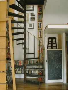 The spiral staircase that winds through books is cool by itself, but it looks to me like you can take a break halfway through your book-filled climb and stop on that stool to read or use the desk. I'd replace that stool with a comfy chair, but I love. Espalier, Stair Decor, Wall Decor, Wall Art, Sleeping Loft, Interior Decorating, Interior Design, Interior Architecture, Small Spaces