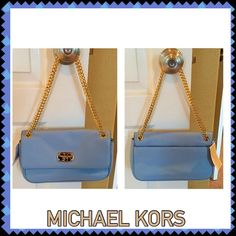 """Michael Kors Leather Jet Set handbag Jet Set with gold chain, shoulder flap is leather in a pale blue with gold tone hardware. Chain can be doubled or single, worn to carry on shoulder tucked under arm or as a cross body! 10""""L x 5""""H x 2""""W. Has flap closure, rear exterior snap pocket and inside has a slit opening on one side with a zipper pocket and 6 credit card slots on other. No trades Michael Kors Bags"""