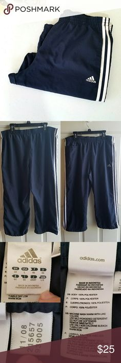"""Adidas Crop Pants. Retro. Gently worn. No stains or holes. Navy Blue with white 3 adidas stripes. Logo on left hip. Small pocket on right upper along with side pockets. Elastic waist band. Drawstring adjustable bottom of pant leg. Material is structured (no stretch beside in waist). Fading to the navy blue color.  Measurements  Inseam length 21"""" Length 30"""" Waist (flat lay mm) 16"""" (not stretched for mm) Hip (flat lay mm) 21""""   Always willing to negotiate. Make an offer. adidas Pants Track…"""