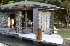 Balinese decor at North Island, Seychelles wall of lees/flowers/outside instead of curtains or gazebo wood