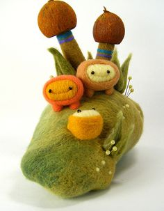 Cute needle felted characters by Kit Lane.