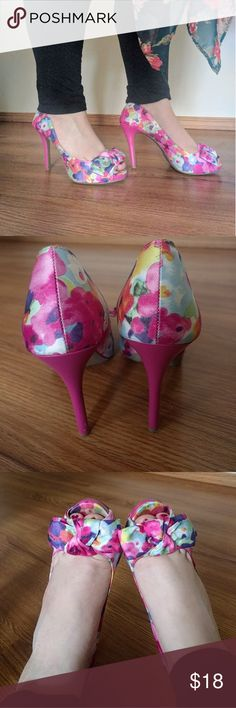 Floral Bow Heels Beautiful peep toe pink, light blue, purple, and orange floral pattern with solid hot pink 5 inch heels with bows on the toes. There is some tanning lotion stains on the inside and a scratch at the very bottom of the left heel (picture #7) FIONI Clothing Shoes Heels