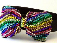 $19.99 Bling Bling! Bow Headband with Multi Color Rhinestones with Yellow, Pink, Red, Green & Blue. . Perfect for Women, Teens & Girls, Bling Bling Hair Accessory. Perfect for Christmas Stocking Stuffer, Church, First Communion, Easter, Graduation, Sunday Dress, Christening or Birthday. by Hail Mary Gifts, www.amazon.com/...