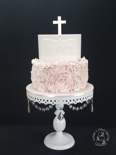 A Christening cake in lovely soft pink with rosette ruffles. www.facebook.com/cakesbyleannerhodes