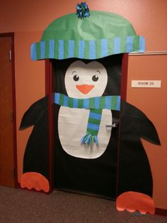 Penguin classroom door. He's a little chubby after all the Christmas goodies.