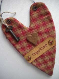 Fabric heart ornament is sewn, teastained and embellished with a rusty key, handmade cinnamon heart, buttons and a tag that reads Together. Rusty wire is attached to top for hanging. Primitive Christmas Ornaments, Prim Christmas, Country Christmas, Felt Ornaments, Christmas Trees, Valentine Day Crafts, Valentine Decorations, Christmas Crafts, Valentines Hearts