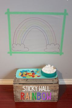 Sticky Wall Rainbow Art - tape contact paper to the wall sticky side out, draw a pic onto it, have kids stick on colored paper and cotton balls.  Fun!