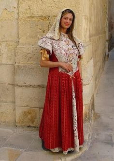 Maltese lady in traditional dress, Mdina, Malta