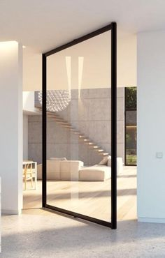Double glass door with steel look frames portapivot h o m e whats your thoughts on this minimal steel framed glass door glass pivot door with central axis pivoting hinge designed by porta pivot stunning planetlyrics Choice Image