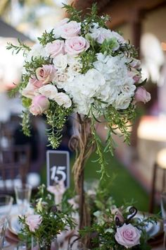 garden style centerpieces | Found on colincowieweddings.com