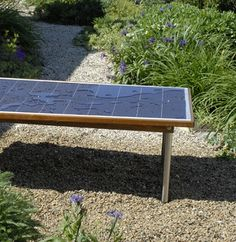 Waterproof outdoor solar panel table that can power your electronic devices (think laptop, phone, etc.)