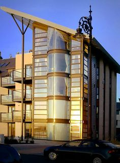This interesting abode is in Dundee, Scotland. It's glass structure gives residents tons of natural sunlight.