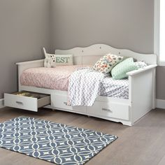 Create a fairy tale wonderland in your child's bedroom with the Tiara Twin Daybed. With three storage drawers below with darling chrome handles, this daybed showcases decorative cut and jewel like insets on the headboard for a tiara-like look.