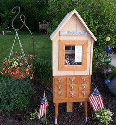 Samantha Garvey. Johnson Creek, WI. I am a school library media specialist. My husband and our son made the Library using parts from an old library card catalog. It was a birthday gift for me that they spent months working on as one of my son's Boy Scout requirements.