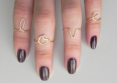 Hey, I found this really awesome Etsy listing at http://www.etsy.com/listing/150582725/personalized-initial-knuckle-ring