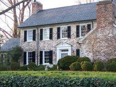Whitewash brick with black shutters