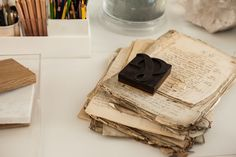 Paper weight and ancient papers. From the office of interior designer NICOLE HOLLIS. San Francisco.