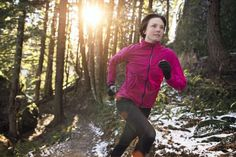 Woman running in the woods - Mike Powell/Getty Images