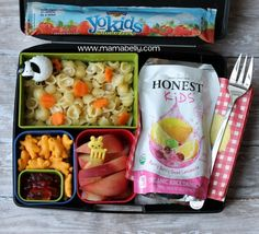We rocked this Laptop Lunches bento box by packing a Stonyfield YoKids Squeezer, Annie's Shells and White Cheddar pasta with carrot flowers, Annie's Cheddar Bunnies, Annie's Bunny fruit snacks,  a sliced peach, and an Honest Kids Berry Berry Good Lemonade pouch.