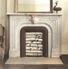 Iffers Little Nest: Decorating Nonworking Fireplaces...and this is practically MY exact same fire place too!!!