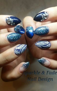 Peacock colored gel nails with swarovski crystals and handpainted abstract designs - Done by Christine Ingalls of Sparkle and Fade Nail Design  https://www.facebook.com/SparkleAndFadeNailDesign