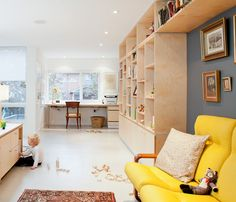 Custom birch millwork, fabricated by Toronto's Gibson Greenwood, defines a home office space on the second floor. Susan brought the yellow couch at right when she emigrated from Hungary in 1969. Photo by: Sean Galbraith