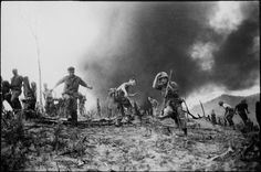 S Marines scatter as smoke from a shot down helicopter spreads. Fass shot the picture on July 15, 1966.