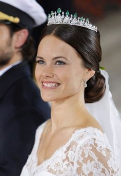 The latest tiara-wearing addition to the Swedish Royal Family, Sofia Hellqvist wed Prince Carl Philip on 13 July 2015. The diamond and emerald tiara worn by Sofia was originally a necklace given to Queen Silvia by a Prince of Thailand, revamped  and put on a tiara frame to great effect
